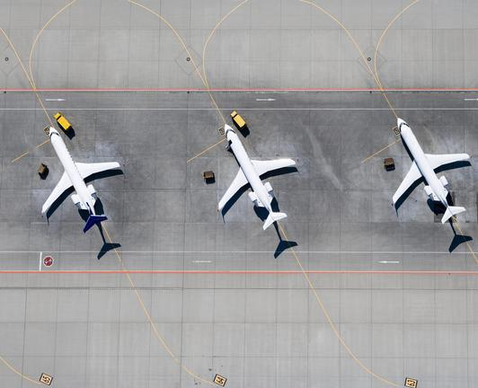 three airplanes lined up to be inspected